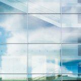 GlasCampus Torgau News - Glasfassade eines Bürogebäudes mit Reflektion auf den Scheiben